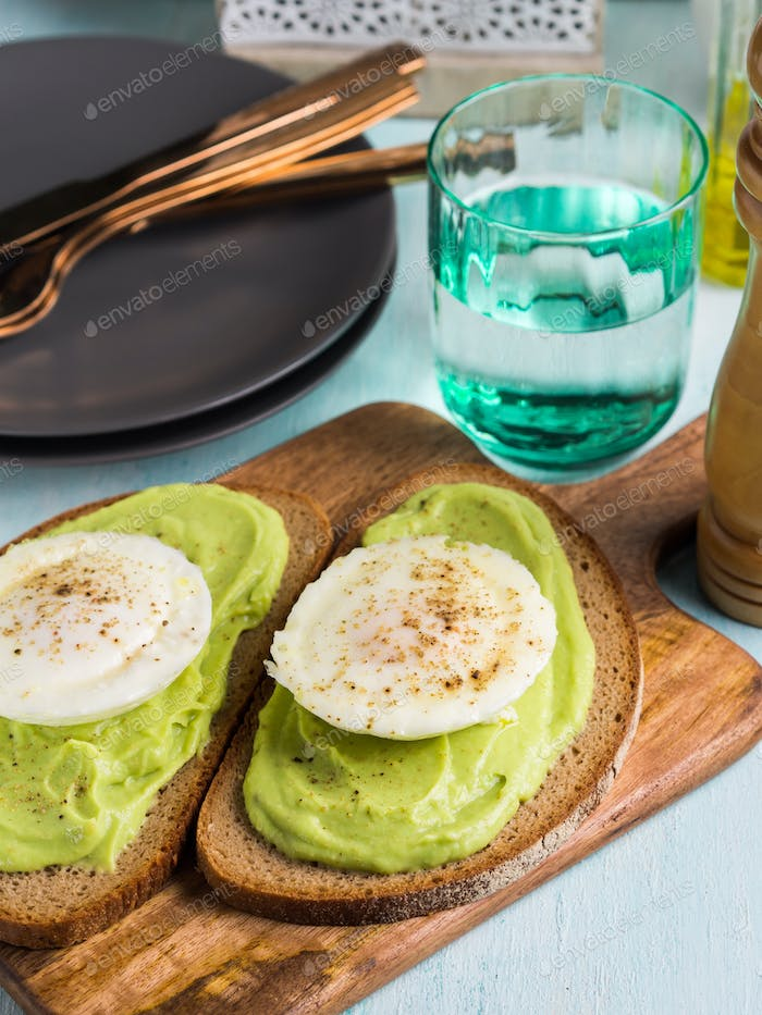 Rye bread avocado toasts with poached egg