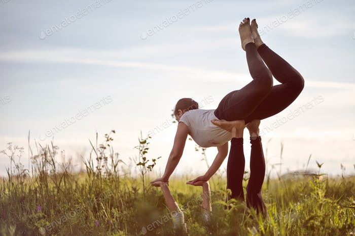 two woman on field doing fitness yoga