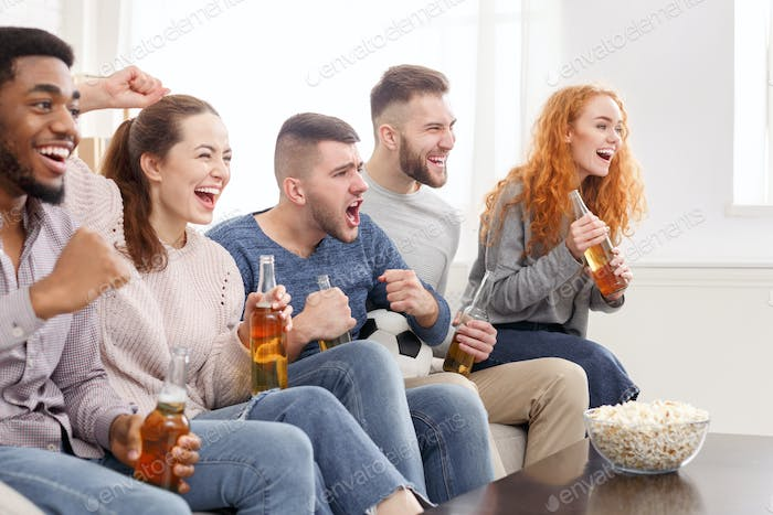 Cheering for favourite team. Friends watching match