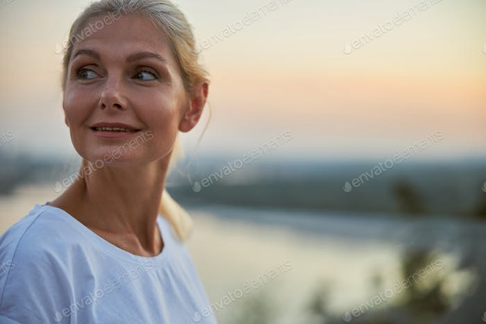 Attractive lady in a white t-shirt looking away