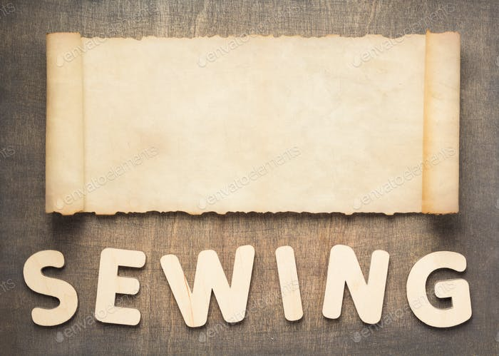 sewing letters and parchment scroll