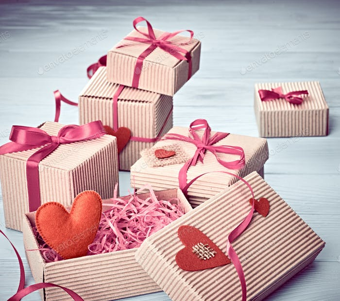 Love, Valentines Day.  Hearts, gift boxes on wood