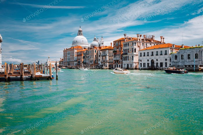 Grand Canal turquoise water and Basilica Santa Maria della Salute against blue sky, Venice, Italy