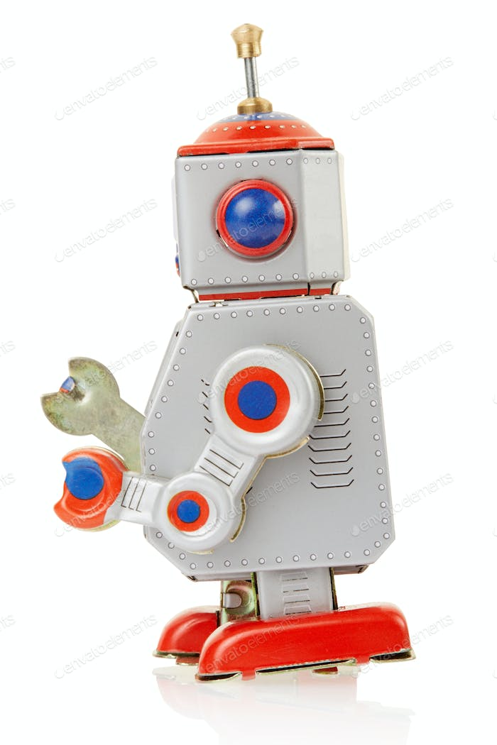 Robot vintage toy side isolated on white, side view