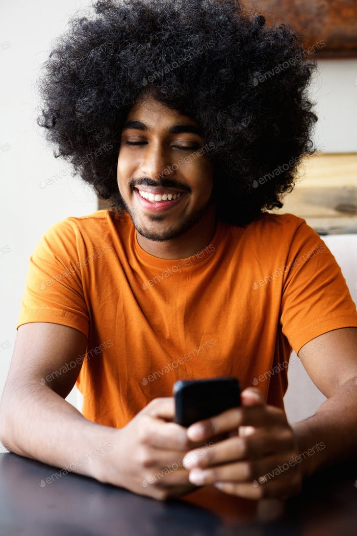 Happy guy looking at cellphone