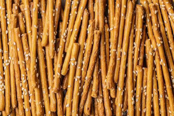 Salty sticks. Crunchy pretzels with sesame seeds.