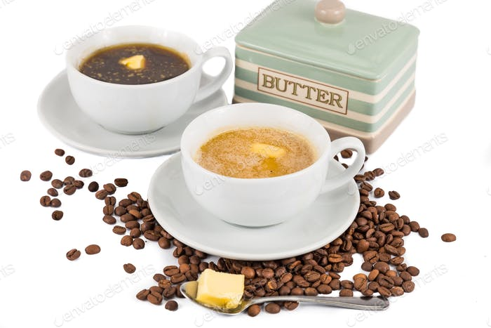 Black coffee with added butter at the foreground and coffee with milk and added butter at the back