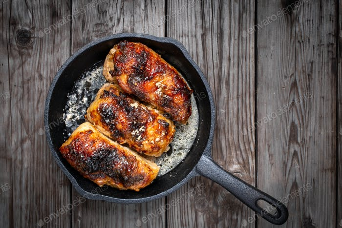 Chicken pieces in pan above