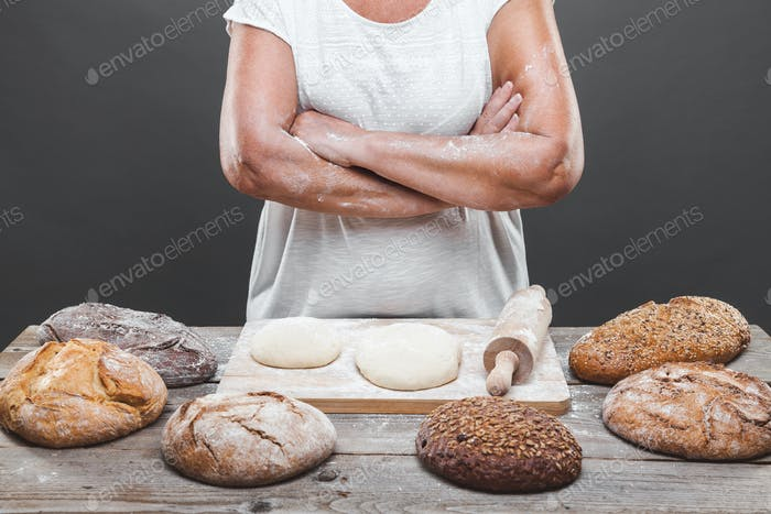 Baker preparing delicious fresh bread and pastry