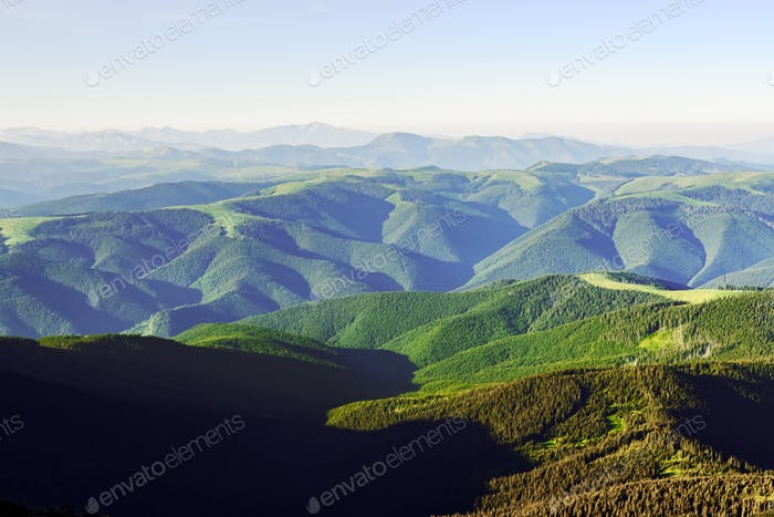 Green mountains range in summer time
