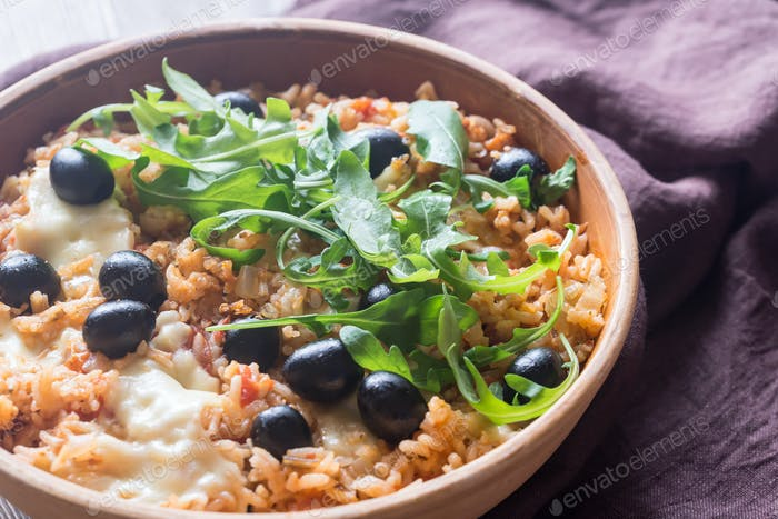 Bowl of tomato, olive and mozzarella rice