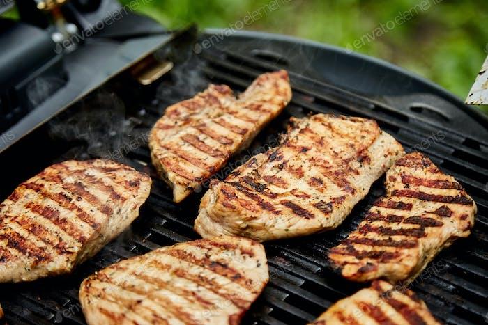 Grilled turkey meat. Steak turkey grill on on huge gas grill .