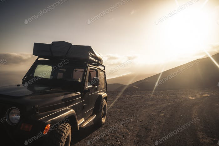 Travel with car and tent on the roof