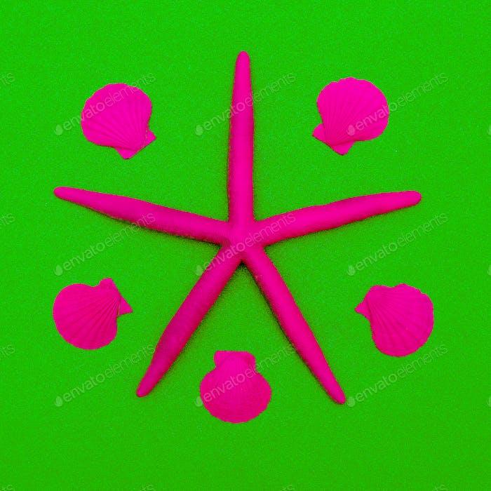 Pink neon starfish and seashells. Minimal design