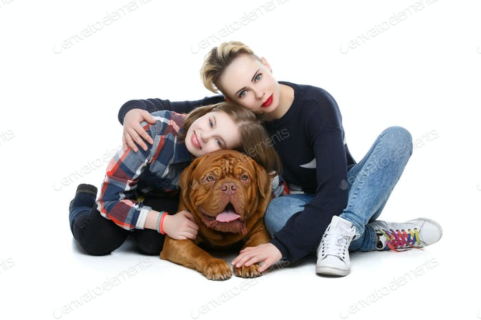 Girls with big brown dog
