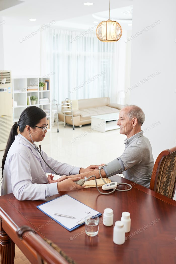 Doctor with senior patient at home