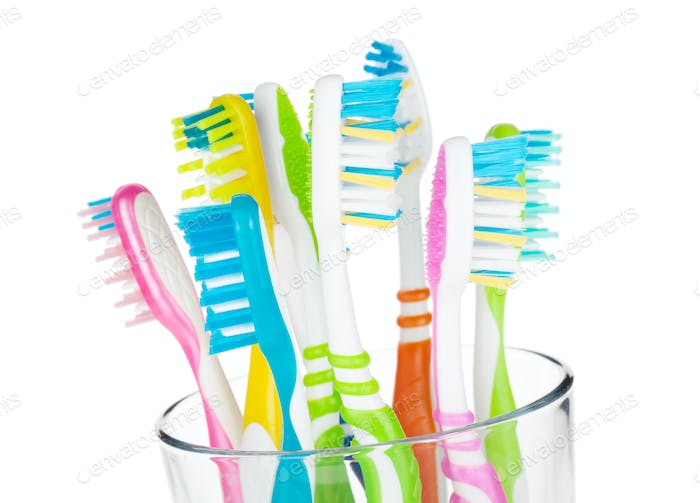 Colorful toothbrushes in glass