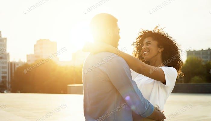 Enjoy moment. Loving couple hugging at sunset