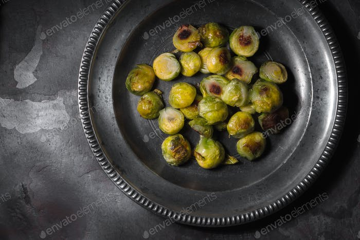 Baked Brussels sprouts in the metal plate