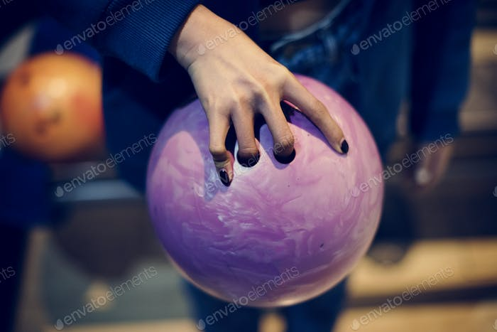 Grabbing the pink bowling ball