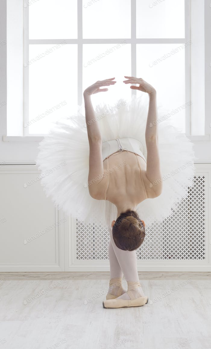 Beautiful ballerine dance in ballet position, reverence