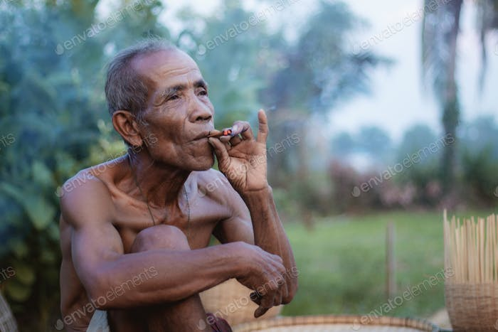 Old man are smoking in Thailand