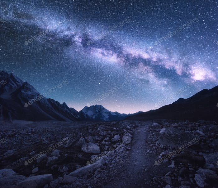 Space. Milky Way, mountains and trail at night