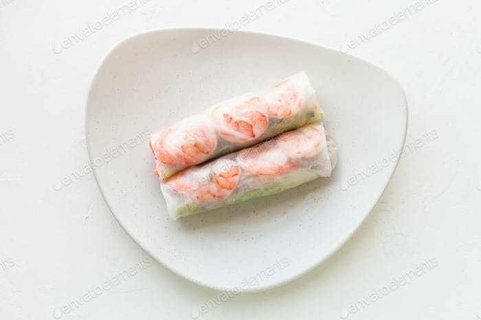 Vietnamese nem roll with shrimps on plate on board