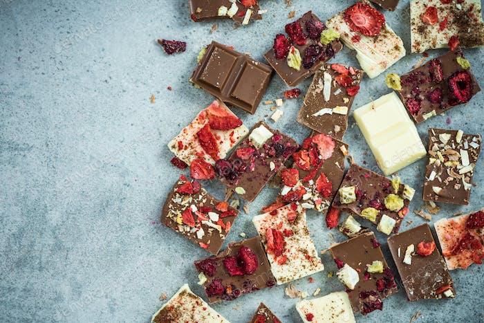 Artisan handmade chocolate pieces,border background