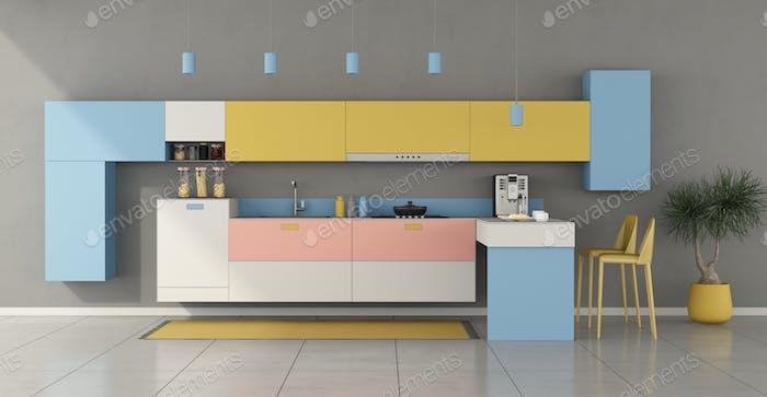 Colorful minimalist kitchen with peninsula
