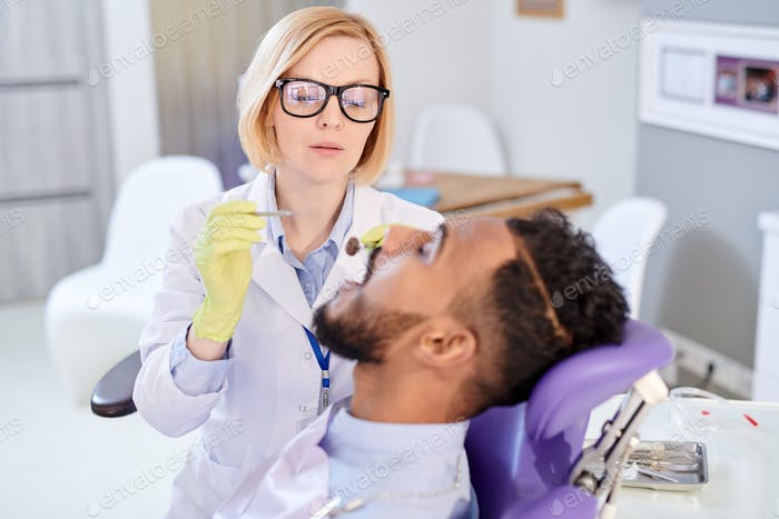 Pretty Dentist Having Appointment