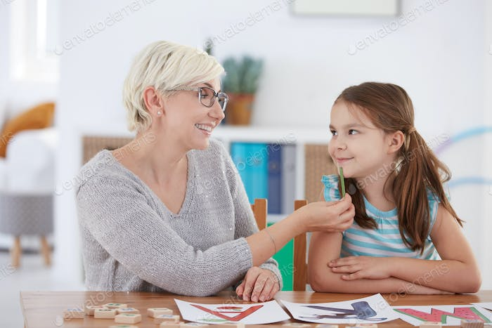 Smiling woman looking at girl