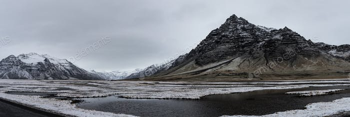 Beautiful panoramic winter landscape view of Iceland, snow cappe