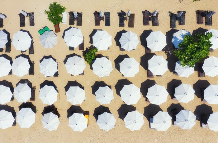 Umbrellas as a background from top view. Beach and sand background from top view.