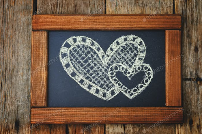 two hearts drawn on a chalkboard