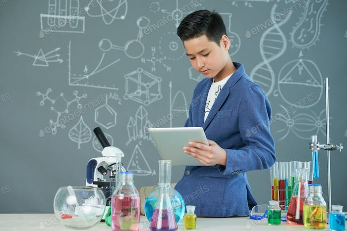 Asian Student Working on Laboratory Report