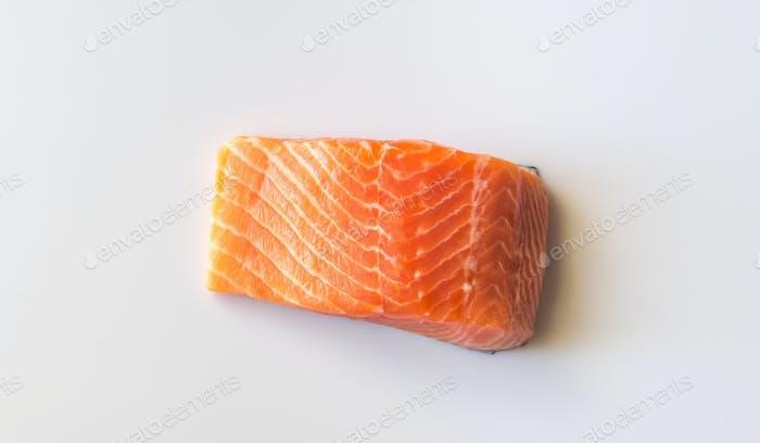 Raw salmon on the white background