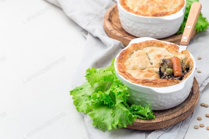 Vegetarian pot pie with lentil, mushroom, potato, carrot and gre
