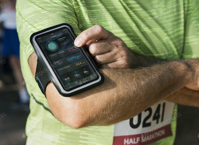 Senior runner using a fitness tracker application