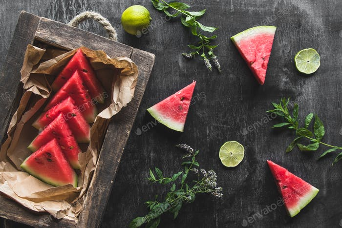 Watermelon in a wooden box. Sliced to pieces of watermelon