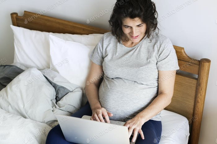 Pregnant woman using computer laptop