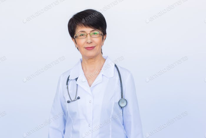 Portrait of doctor woman with stethoscope over white background