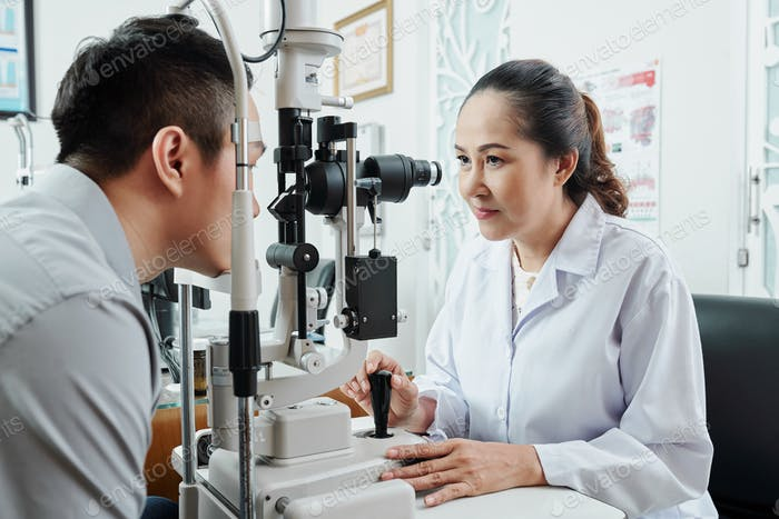 Asian optometrist working at office