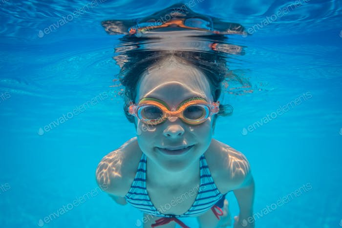 Underwater portrait of child