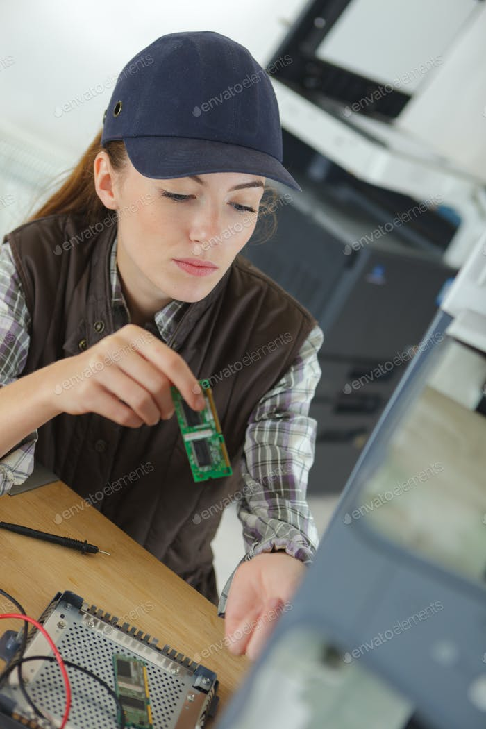Female contractor working on electrical appliance