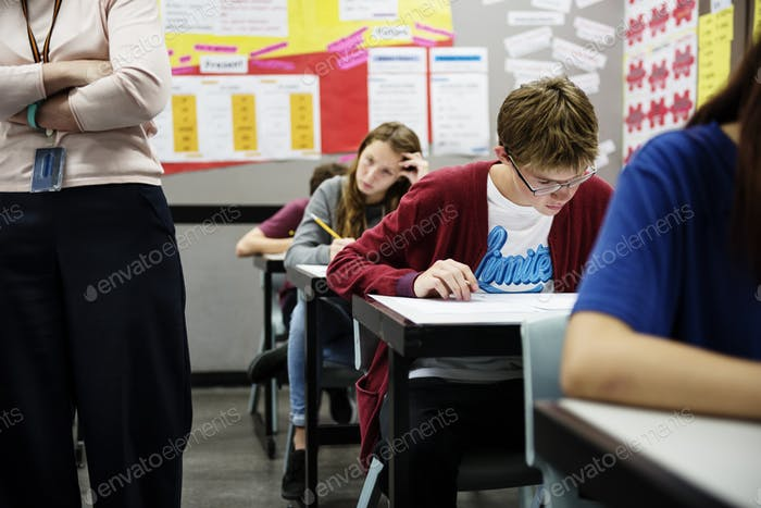 Students doing the exam in classroom