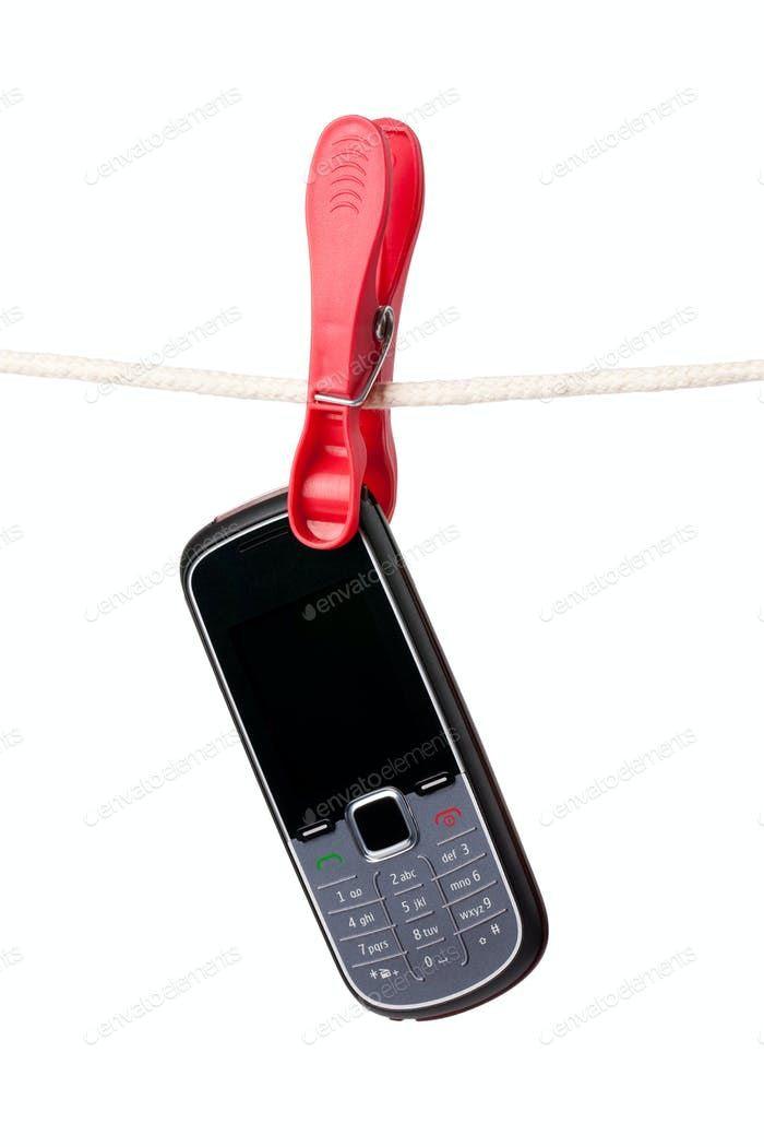 cellphone hanging on clothesline