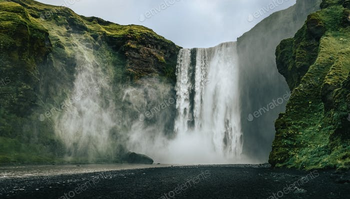 Landscape view of Skogafoss waterfall in cool colors, Skogar, Iceland