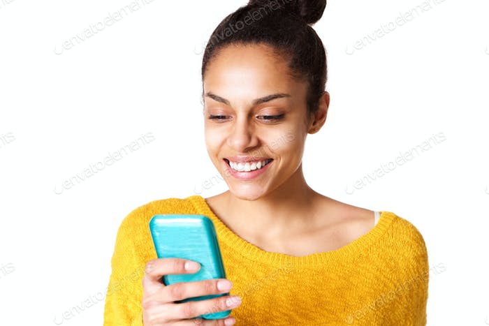 Happy woman reading text message on mobile phone