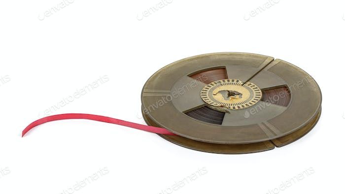 Reel of vintage audio tape on white background